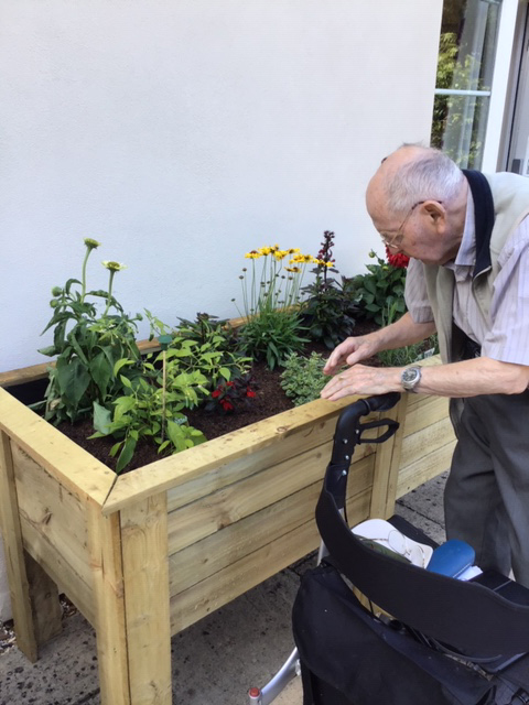 The sun was out and the residents enjoyed tending to the newly planted planters