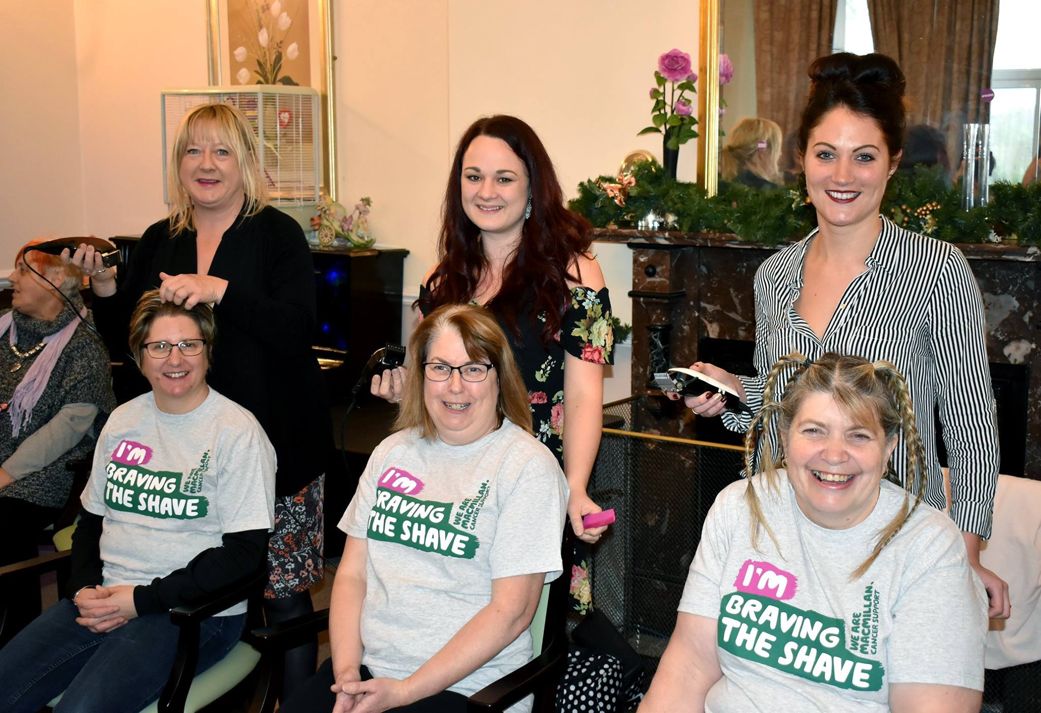 Colleagues braved the shave to raise money for Macmillan Cancer Support