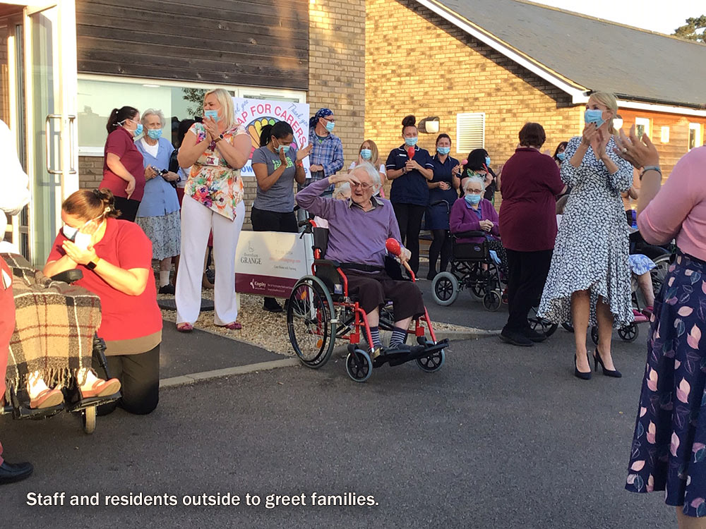 "Residents greet their families at Downham Grange ""drive by"" event"