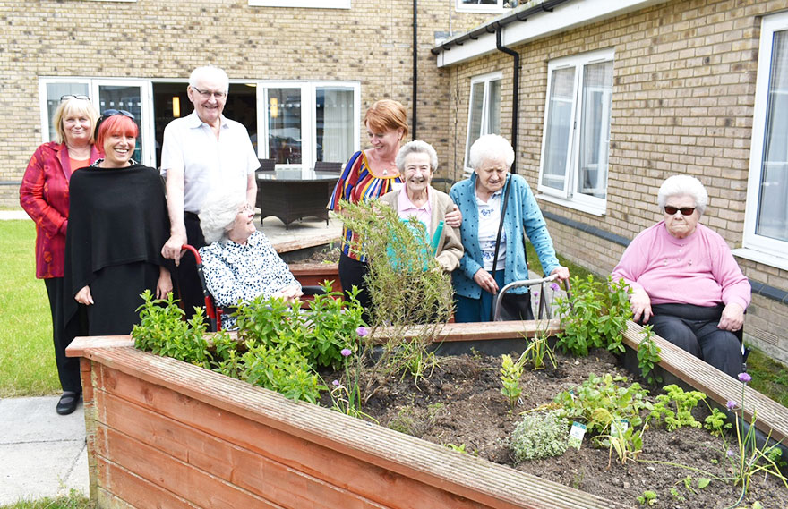 Residents at Downham Grange nursing home hope their green fingers will help them score a double success