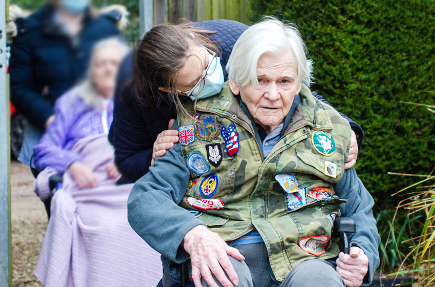 Care home staff and residents follow in footsteps of Captain Sir Tom