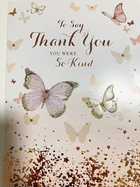 Staff at St Clements Nursing Home receive a thank you card from the family of a resident