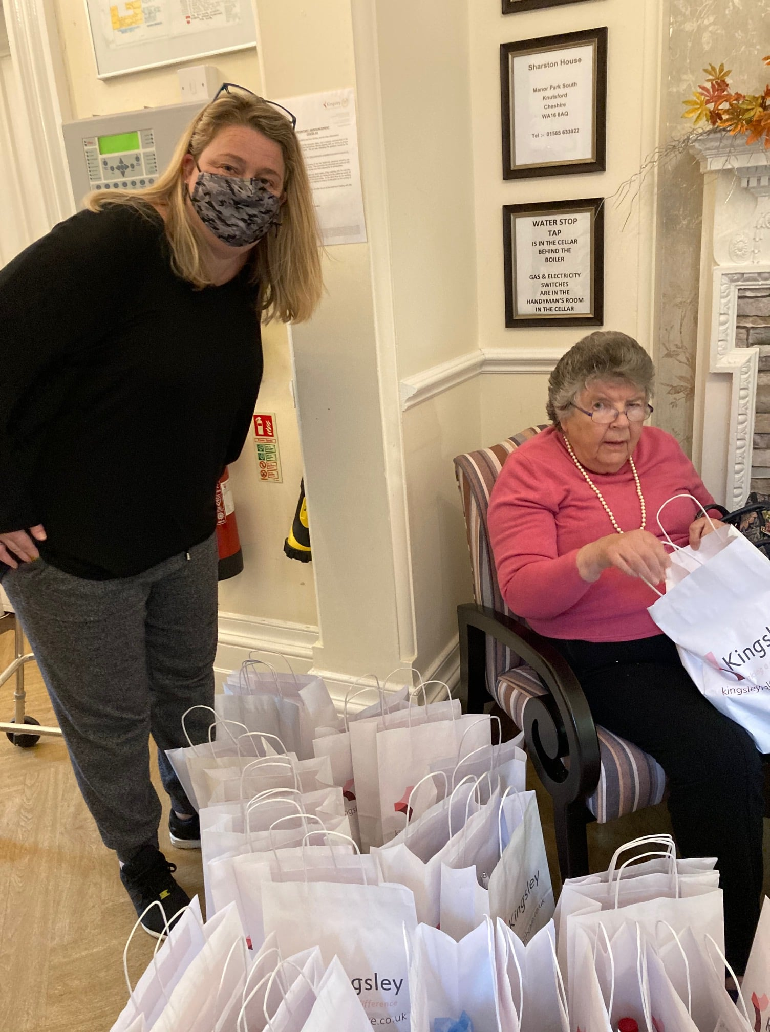 Sharston House Nursing Home presented food bags to the Wilmslow Food Friend project
