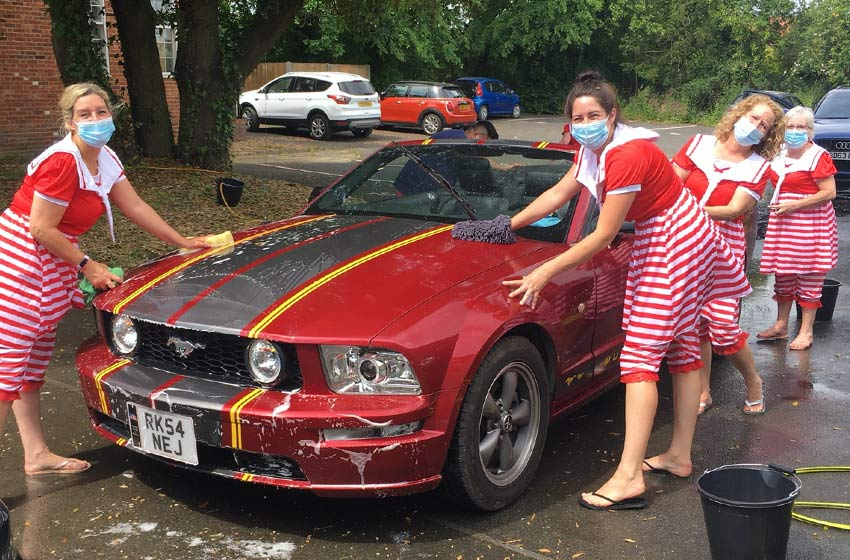 Colne House care home organises car wash to raise money for air ambulance